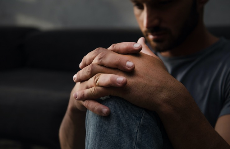 A man sitting in silence as a consequence of anxiety,